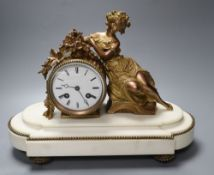 A Louis XVI style white marble mantel clock, with seated female surmount, French bell-striking