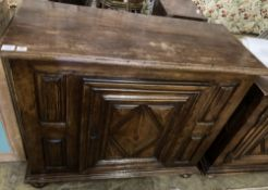 A mid 18th century French provincial walnut cupboard, enclosed by a single door, width 117cm,