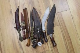Three kukris, a kris and other daggers or knives, longest item 41cm