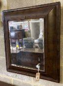 An 18th century style cushioned framed wall mirror, 56 x 63cm