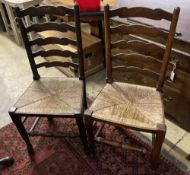 A pair of Lancashire rush seat ladderback chairs