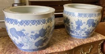 A pair of modern Chinese blue and white fish bowls, 45cm diameter