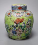 A Chinese lime green ground famille verte jar and cover, late 19th century, 15cm