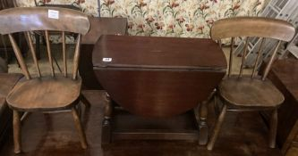 A pair of 19th century child's beech Windsor elbow chairs and an oak drop flap coffee table (3)