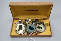 A collection of silhouette jewellery including a memorial ring