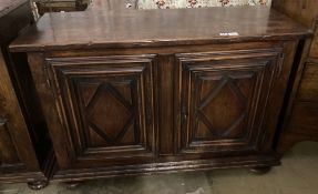 A mid 18th century French provincial oak and elm two door cupboard, with fruitwood top, width 129cm,
