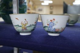 A pair of Chinese famille rose 'Boys' tea bowls, diameter 10cm