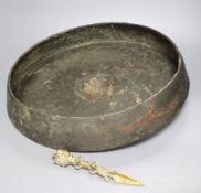 A Himalayan bronze phurba, 19.5cm and an Oriental gong, diameter 46cm