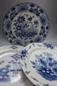 Two 18th century Delft blue and white dishes and a similar English delftware dish, 34-35cm, all a.