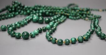 Ten assorted graduated malachite bead necklaces, two with gilt metal spacers, largest