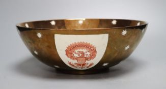 A large Gray's pottery copper lustre American armorial bowl, printed with shield crests in iron red,