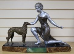 U.Cipriani - An Art Deco style figure of a kneeling lady and a dog, signed, (patinated spelter),