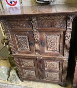 A 19th century Flemish carved oak four drawer cabinet, width 124cm, depth 70cm, height 150cm