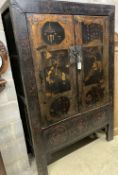 A Chinese lacquer two door cabinet, width 117cm, depth 55cm, height 179cm