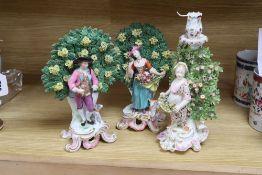 A pair of Samson porcelain bocage figures, and a Samson bocage candlestick figure, latter 28cm