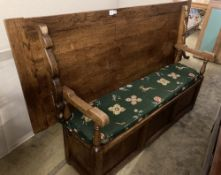 An 18th century style oak monks bench / hall table, width 199cm, depth 72cm, height 117cm