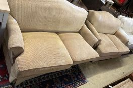 A pair of contemporary beige upholstered two seater settees, width 180cm depth 106cm max height