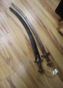 Two 19th century Indian talwar swords, one with scabbard, total length 83 and 88cm
