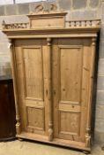 A 19th century Continental pine wardrobe, width 126cm, depth 60cm, height 202cm