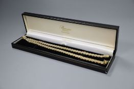 An 18ct yellow and white gold necklace (marked 18K & 750) of panther link design, 25g