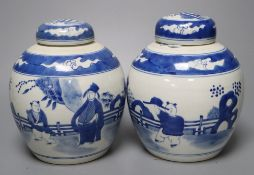 A pair of Chinese porcelain blue and white jars and covers, Qianlong marks but c.1900, 18cm high