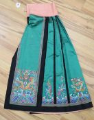 A late 19th century green silk satin Chinese skirt, embroidered in polychrome silks with gold