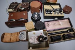 Two boxes of camera lenses and accessories including Voigtlander, Zeiss, Rollei etc