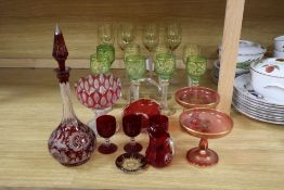 A Bohemian ruby flash glass decanter and stopper, cranberry glass, including a pair of tazzas, a