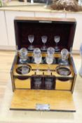 A Victorian burr walnut cased decanter and drinking glass set, some of the glass matched, 40cm wide
