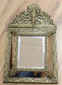 A 17th century style embossed brass pier glass, height 57cm