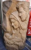 A carved wood relief of Joseph, Mary and Jesus, height 67cm