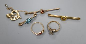 Two yellow metal and gem set rings including 9ct gold, three yellow metal and gem set bar brooches