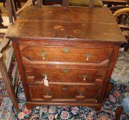 An 18th century oak three drawer chest, width 76cm, depth 53.5cm, height 85cm