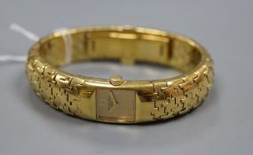 A lady's gilt stainless steel Christian Dior bracelet watch.