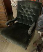 An Edwardian green velvet club armchair, width 75cm, depth 80cm, height 90cm