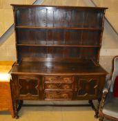 A 1920's Jacobean revival dresser, width 152.5cm, depth 49.5cm, height 188.5cm