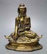 A 19th century Chinese bronze seated figure of Buddha Shakyamuni, seated on plinth, height 21cm