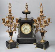 A 19th century black slate clock garniture