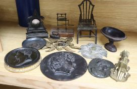 A group of 19th century iron and bronze ornaments, plaques, watch holder and urn