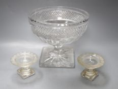 A deeply cut glass pedestal bowl, diameter 20cm and a pair of miniature glass comports, diameter
