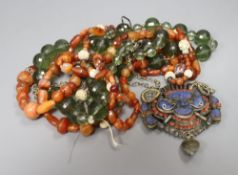 Two Tibetan agate and coral bead necklaces and an Eastern white metal animal pendant on chain