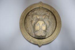 A large cast brass lion's head door knocker, diameter 21cm