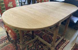 An 18th century style oak gateleg dining table, 175cm extended