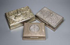 Three Thai white metal cigarette boxes, largest 16.1cm.