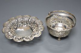 A Chinese pierced white metal 'flowerhead' bowl, diameter 12.2cm, maker 'MT' and a similar small