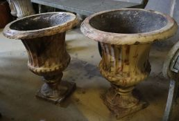 A pair of Victorian faux marble cast iron urn campana garden urns, 39cm diameter, height 46cm