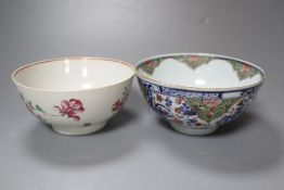 A Chinese Kangxi clobbered bowl and a Chinese Qianlong famille rose bowl