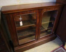 A Victorian mahogany bookcase, width 107cm, depth 25cm, height 92cm