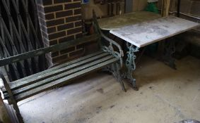 A Victorian painted cast iron slatted garden bench, width 126cm together with two cast iron marble