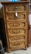 An American stencilled walnut six drawer tall chest, width 61cm, depth 46cm, height 132cm